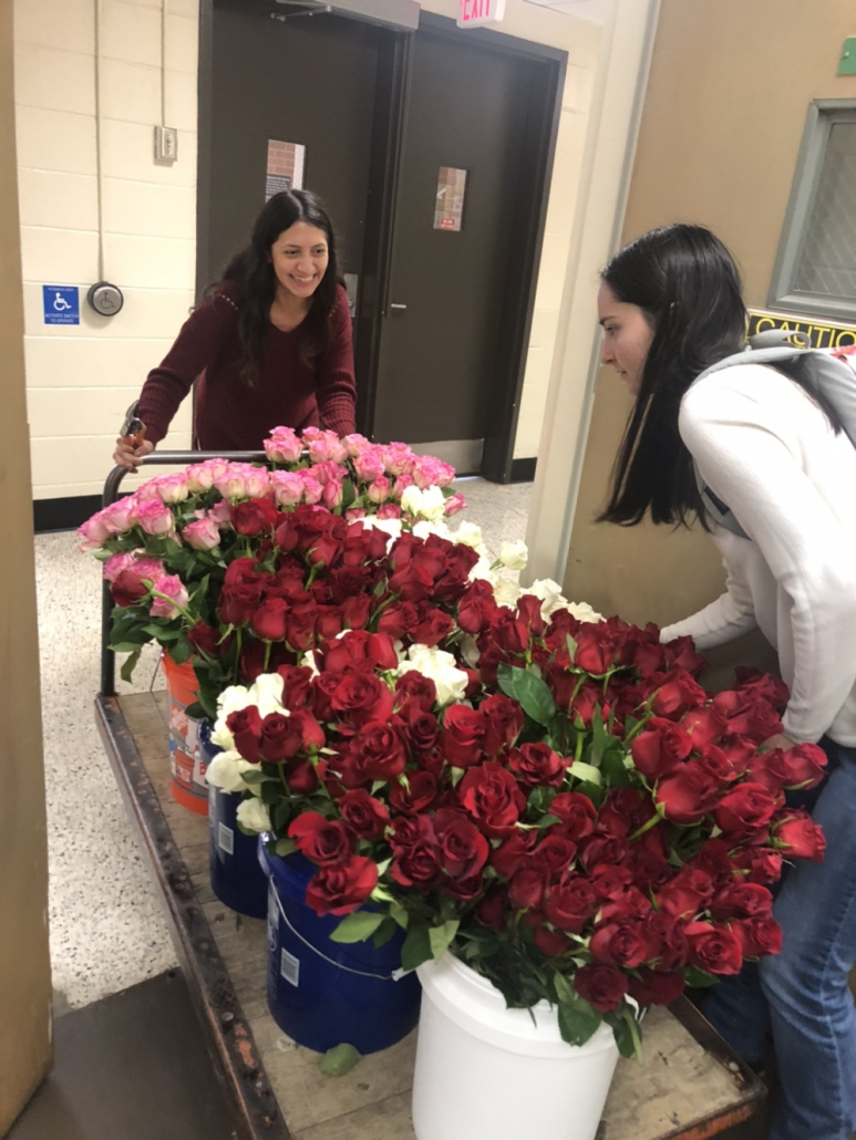 students prepare bouquets of roses