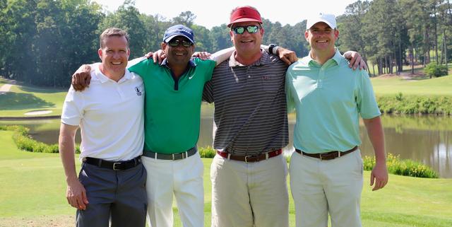 Golfers posing
