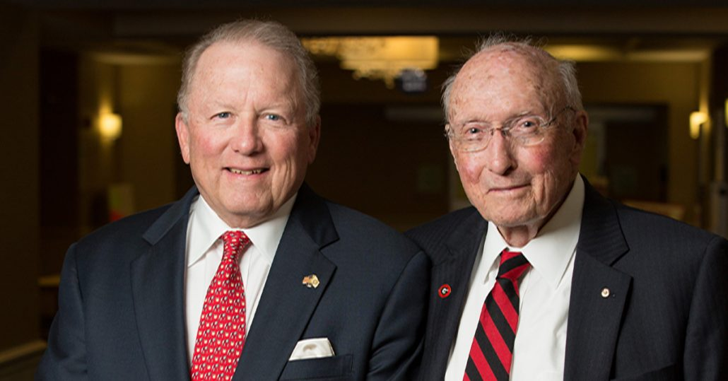 "Larry R. Benson (BBA '74) and father H.E. ""Ed"" Benson (BBA '42)"