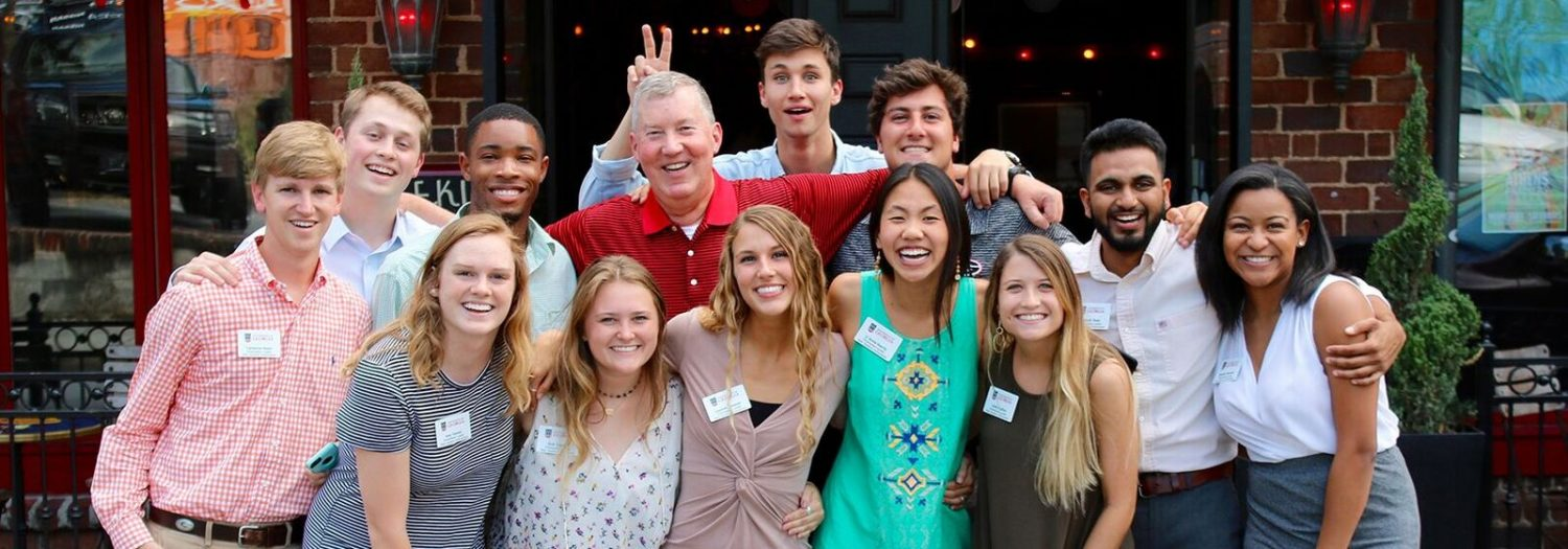 Dr. William McDonald with a group of students