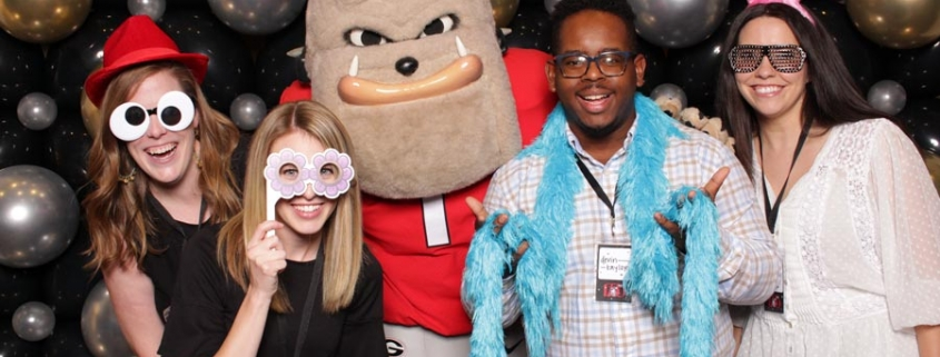 Staff members posing with Hairy Dawg
