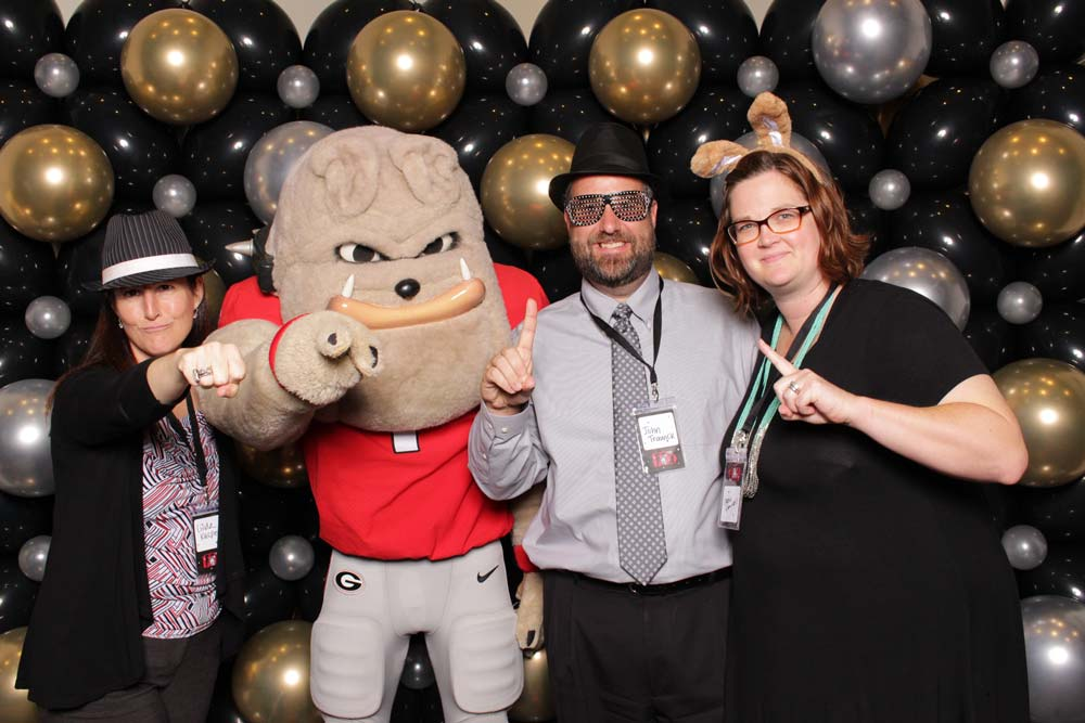 Staff posing with Hairy Dawg